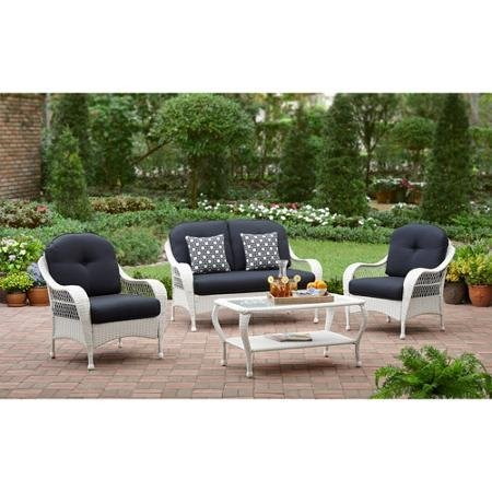 White All Weather Wicker 4 Piece Patio Conversation Set  Perfect Modern Cushioned Conversation Chairs and Loveseat with 2 Toss Pillows and a Glass Topped Coffee Table for Your Home Outdoors by the Grill Firepit Garden or Gazebo