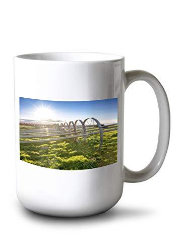 Lantern Press Irrigation Pipe at an Idaho Orchard with Green Grass 9016845 15oz White Ceramic Mug